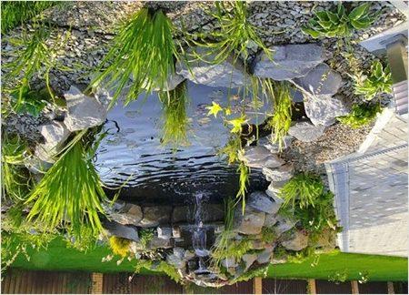 Искусственный водоём с водопадом