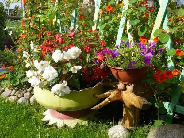 Из старых покрышек изготовим креативные изделия для цветника.