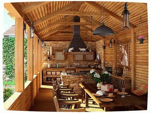 Крытая терраса с печью и кухонными столами превратит помещение в любимое место для отдыха