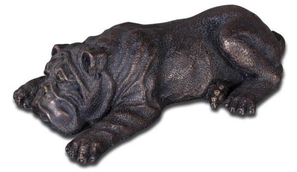 На фото - металлическая статуэтка собаки
