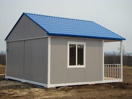 Дом из блок-контейнеров с крышей из металлочерепицы