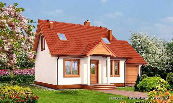На фото уютный и комфортабельный жилой домик с мансардным этажом на садовом участке.